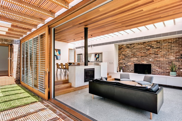 Timber beams, brickwork, louvres and pavers create a striking patchwork of patterns and textures.