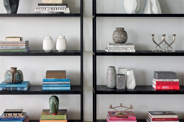 Custom designed bookshelves by de Carvalho in the lounge area house books, ceramics and personal effects.