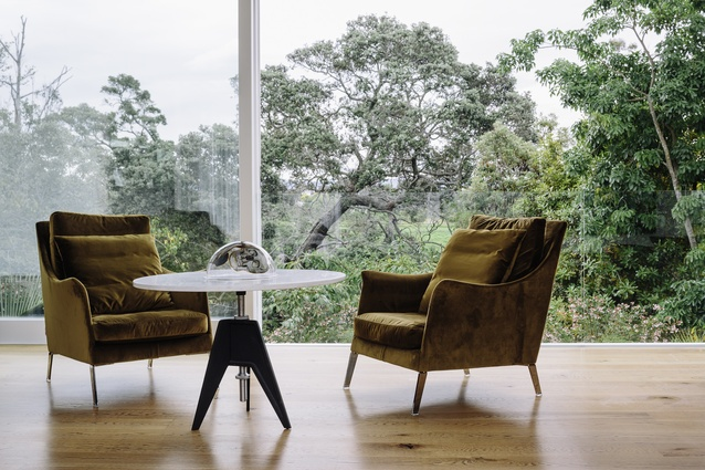 Although the home is not especially large and takes up most of the site, the easy and constant connection to the outdoors visually extends and expands the living spaces.