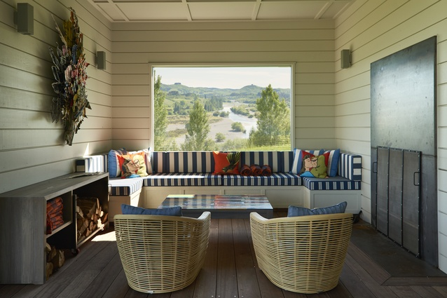 The verandah snug is a riot of colour, set in motion by a corrugated steel Jeff Thomson work. Striped and tweed outdoor fabrics from Westbury on built-in seating and cane Global chairs (Design Warehouse), set off with Dick Frizzell cushions.