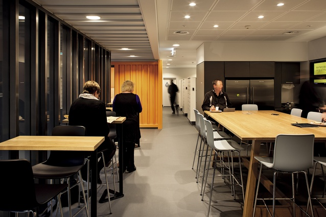 The café space is also an alternative work area. Lockers in the background are provided for staff to store belongings.