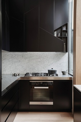 The angles of the stair are carried throughout the home, including in the kitchen joinery.