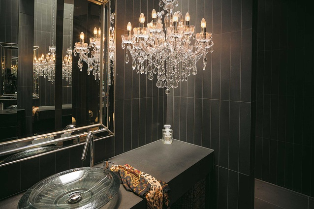 The powder room, with venetian glass vanity bowl by Kohler, on a basalt plinth and wall by Island Stone.
