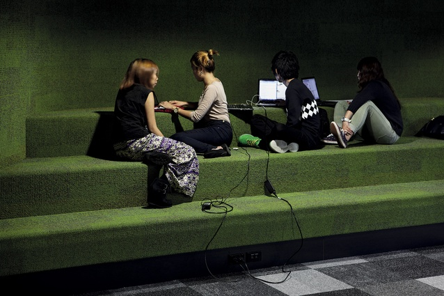 Carpeted bleachers in an area that can be curtained off to form an impromptu learning space.