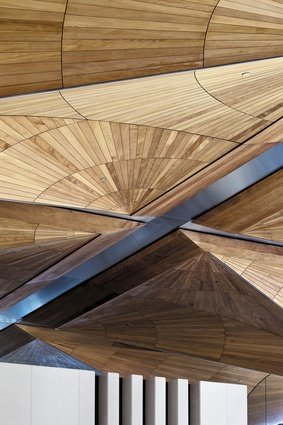The kauri canopy extends into the intricately patterned ceiling of the northern atrium and main entrance.