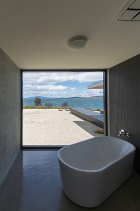 A minimalist bathing space on the house's west end allows its users to soak in the views.