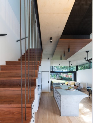 An ironbark stair continues from the corridor of the existing cottage.