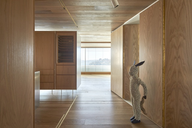 Timber is used throughout the apartment to create a feeling of warmth and intimacy.