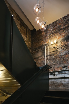 A material contrast: old bricks and black steel sit comfortably in each other's company.