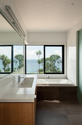 Ensuite bathroom with a view over the ocean.