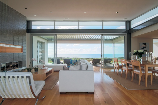 Clearstory windows allow light to spill over the covered terrace and into the living area.