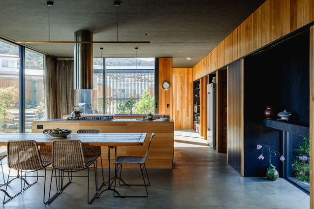 The ceiling panels have been painted black and the walls were lined with Tasmanian oak boards.