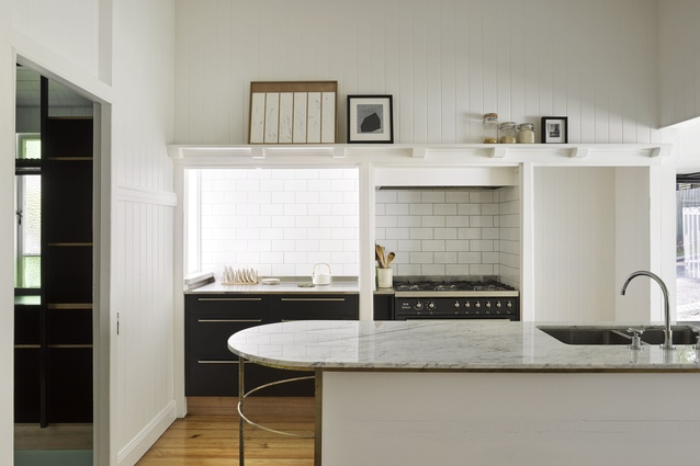 The kitchen is connected to a large, informal space dedicated to dining, studying, gathering and playing.