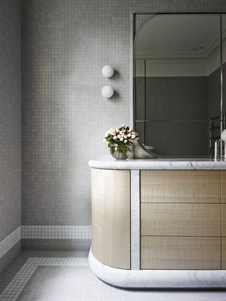 High-end finishes and details of the Private Residence bathroom complement the joinery's curved edges, creating a sophisticated aesthetic with old-world charm.