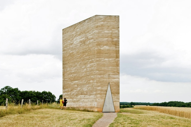 Bruder Klaus Field Chapel, Germany by Peter Zumthor. Concrete was poured on top of a wigwam of 112 treetrunks and then set on fire, leaving behind a hollowed blackened cavity.
