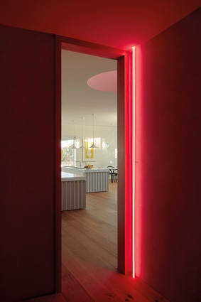 A neon-lined lobby, which recalls the work of Dan Flavin, services both penthouses.