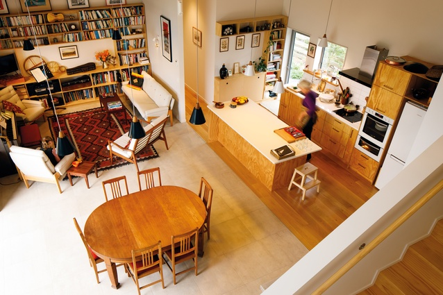 The view of the kitchen/dining/living area from the mezzanine study.