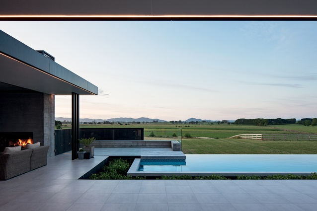 In lieu of pool fencing, a moat with hedging was devised to separate the patio and pool areas, so as not to obstruct the rural view.