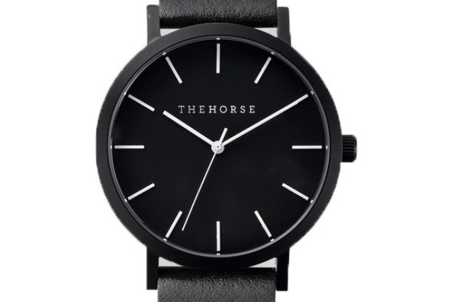 The watch is available with a matte-black case and a black leather band.