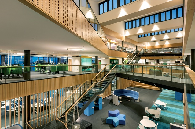 An ample atrium with a variety of bridges allows for visual and physical connections between staff.