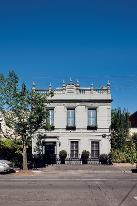 The striking Victorian facade of the renovated home.