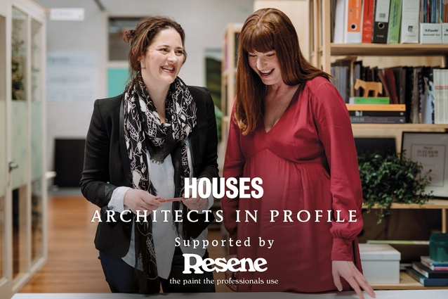 Eva Nash and Kate Rogan discussing house plans in their Morningside Drive studio, near Kingsland, Auckland.