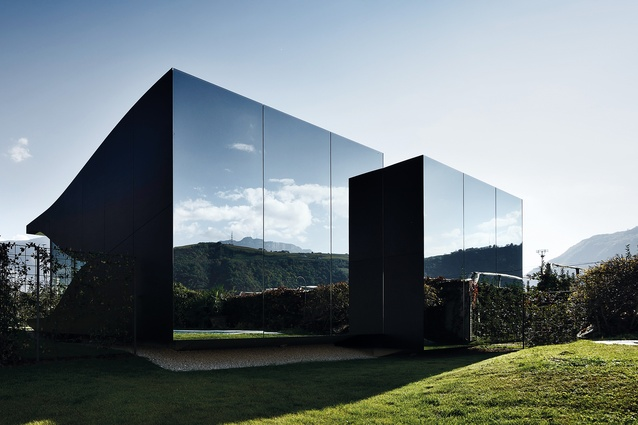 The sleek structure works remarkably well with its position in the rugged landscapes of Italy's Southern Tyrol.