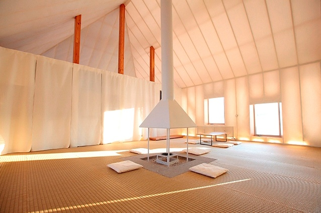 Kengo Kuma's Meme Meadows Experimental House, Japan. The translucent cabin has a thick layer of polyester insulation made using recycled plastic bottles that allows light to pass into the house.