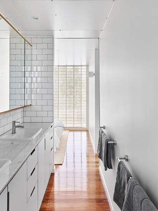 The extruded brick screen is used to its full effect in the bedrooms and bathrooms as a delicate layer of privacy.