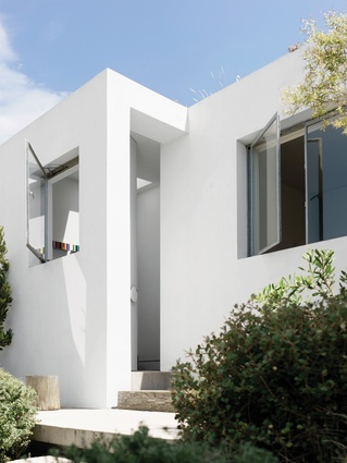The facade is finished in an all-natural mineral-based render that will gradually patina with exposure to the elements.