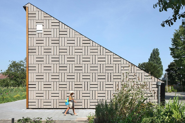 Nature & Environment Learning Center, Netherlands by Bureau SLA. The building features a passive solar heating and cooling system that is known as a Trombe wall.