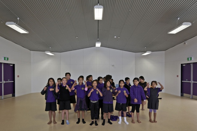 Children congregate in the assembly hall, the 'heart' centre of the building.