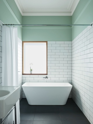Black tiles used for the bathroom are also used on the kitchen bench, revealing an interest in unitized materials.