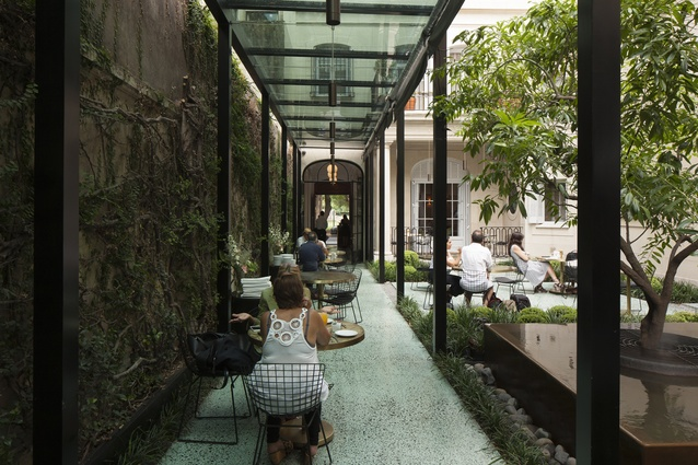 This landscaped area of Casa Cavia is used as an alfresco dining space but also has a cocktail bar in green marble.