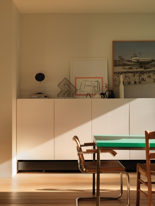 The restrained design provides a backdrop to an eclectic collection of art and collected objects. Artwork (L-R): Lincoln Austin (sculpture); Julian Hocking; Joel Sternfeld.