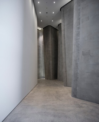 Stepping into the Centre one gets the feeling of walking backstage through an undulating concrete curtain.