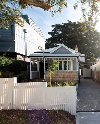 Externally, the weatherboard cottage has been restored to near-original condition.